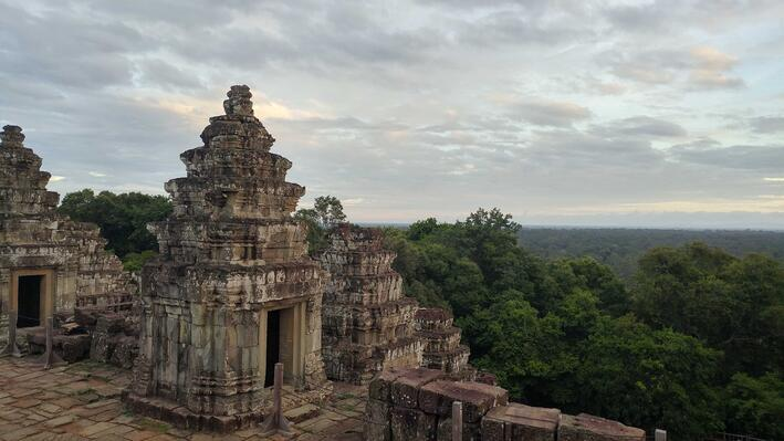 A temple overlooking a forest in Cambodia