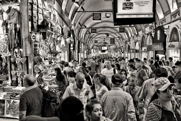 grayscale-photo-of-people-at-market