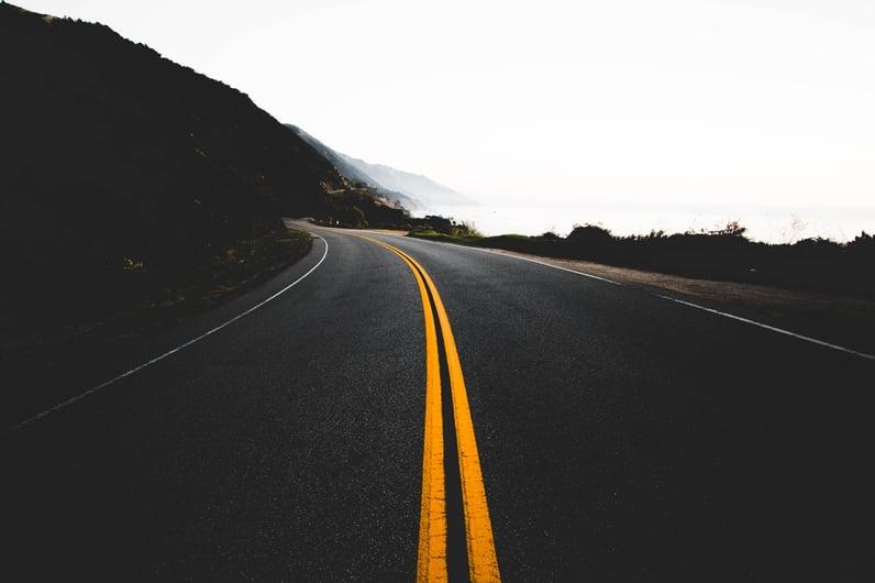 empty-road-foggy-mountain